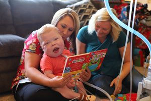 Cayden working with his nurse, Stacy Mahley, LPN and his occupational therapy assistant, Lindsay Martin, OTA