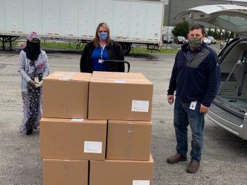Alene Candles representatives and MCBDD representative ready to load the supplies