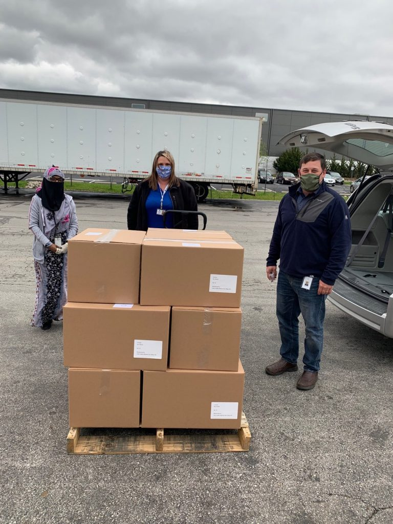 Pictured with boxes of shields: Farhiyo Alasow and Darrell Finck of Alene Candles (ends), Tabitha Butcher, Marion County Board of DD (center) meet to load up the boxes and bring back to the COG's PPE Headquarters in Marion