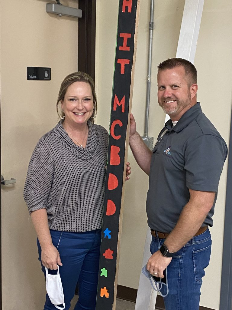 Wings of an Angel, R.I.S.E. Owners, Heidi & Ryan Ballinger pose with a Peace Pole that was designed by attendees of the program