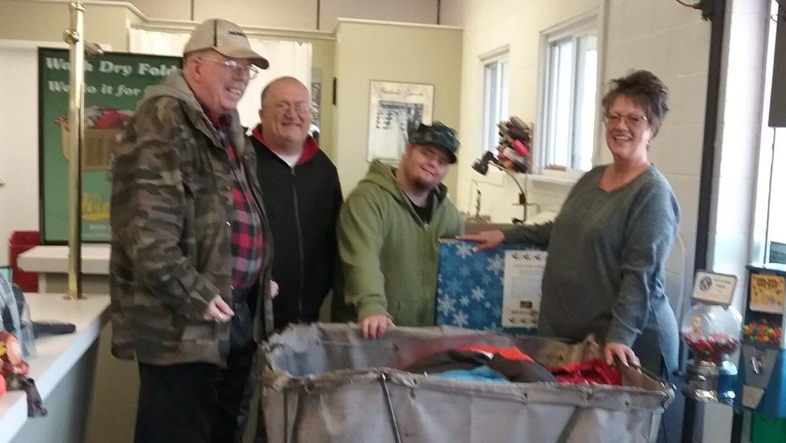 Volunteering for iHeart Radio's Coats for Christmas.